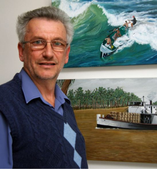 Mori with two paintings by his artist wife, Kham; a Palm Beach surfboat and the 1910 Murray River paddle steamer Pevensey
