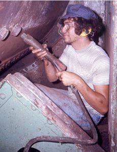 Mori needle gunning Waratah's boiler about 1976